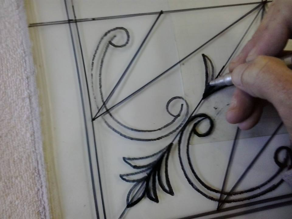 Drawing the design on the glass